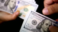 Close up of paying cash from man's hands counting video