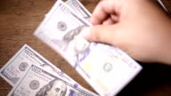 Close up of paying cash from man's hands separate video