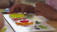 Close Up Of Pupil Using Flower Shapes In Montessori School video