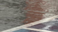 Close Up of Rain on Tarmac with Car Park Lines, Water Drops Bouncing video