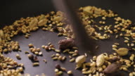 Close up of raw spices being prepared in a pan for Indian curry video