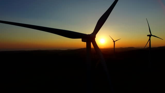 Close up of rotating windmill blades at sunset video
