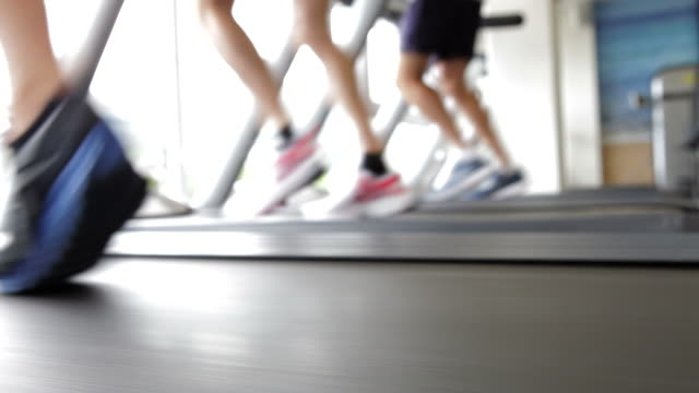 Close Up Of Runners Feet On Running Machine In Gym video