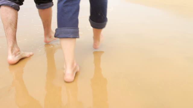 Close Up Of Senior Couples Feet Walking Along Beach video