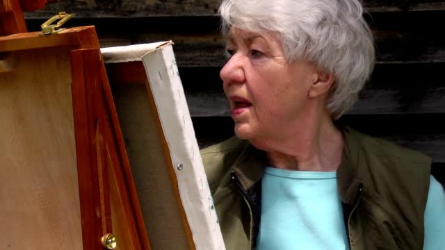Close up of Senior Female Painting video