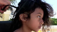 Close up of six year old girl getting hair braided video