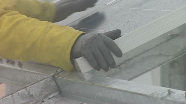 Close up of solar panel being installed in bad weather video