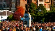 Close up of Soldier Memorial Cenotaph and Very Large Crowd on Remembrance Day video