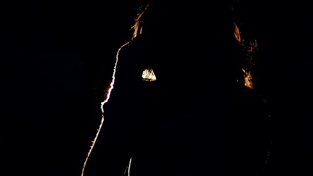 Close up of the girl boxing in the dark. Slow motion. video