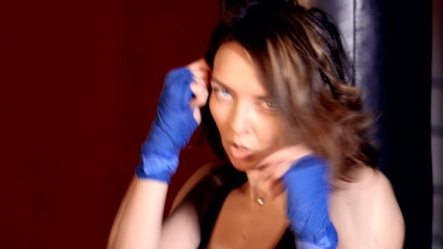 Close up of the woman with boxing handwraps trainig. video