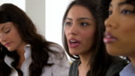 Close up of three business women working together in office video