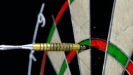 Close up of three darts hitting triple twenty on a dart board video