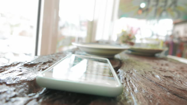 Close up of using  smart phone in cafe video