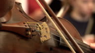 Close up of Violin bridge played with bow video