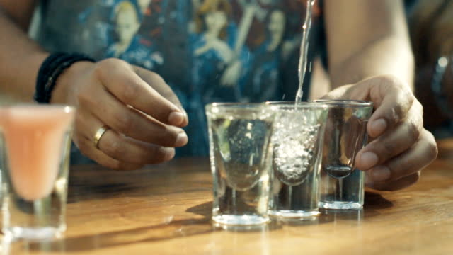 Close Up Of Vodka Poured Into A Shot Glass video