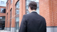 Close Up of Walking Man in Suit, Back View video
