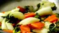 Close up of woman cooking vegetables video