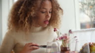 Close Up Of Woman Enjoying Meal In Restaurant video