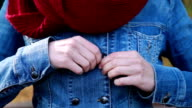 Close up of woman hands unbuttoning jacket video