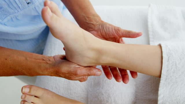 Close up of woman therapist massaging the feet of her patient video