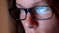 Close Up Of Woman With Glasses Using Computer video