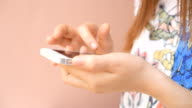 close up of women hand touching screen on modern mobile smart phone. video