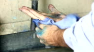 Close up of worker cleaning hands video