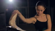 Close Up of Young Ballerina Stretching video
