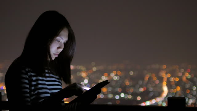 Close up of young woman touching tablet on roof top at hotel , 4k(UHD) video