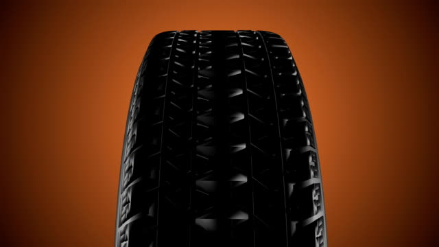 Close up on a car tire in motion. Seamless loop video