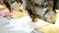 Close up on an embroidery machine making a shape heart video