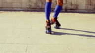 Close Up on Girls Feet While Riding Roller Skates video