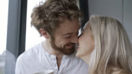 Close up on loving couple talking and kissing video