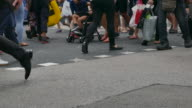 close up people walking in orchard road singapore video