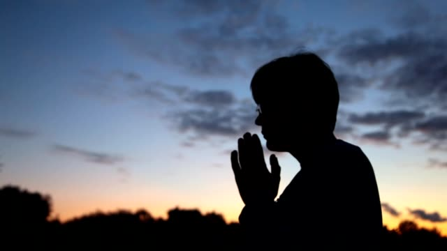 Close up person prayerfully putting hands video