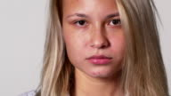 Close up portrait of beautiful sad female teenager video