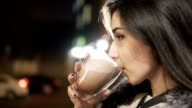 Close up portrait of young brunette woman with big mug of hot drink during cold day. video