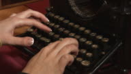 close up - she prints a very old typewriter video