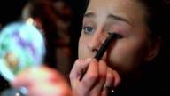 Close up shot of a beautiful woman applying make up eyeshadow video