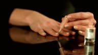 Close up shot of a female hands doing manicure applying nail polish to fingers video