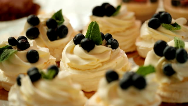 Close up shot of blueberry cakes from the wedding candy bar. video