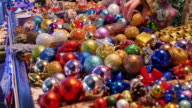 Close up shot of colorful Christmas balls being sold on a Christmas market video