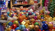 Close up shot of colorful Christmas balls for sale on a Christmas market video