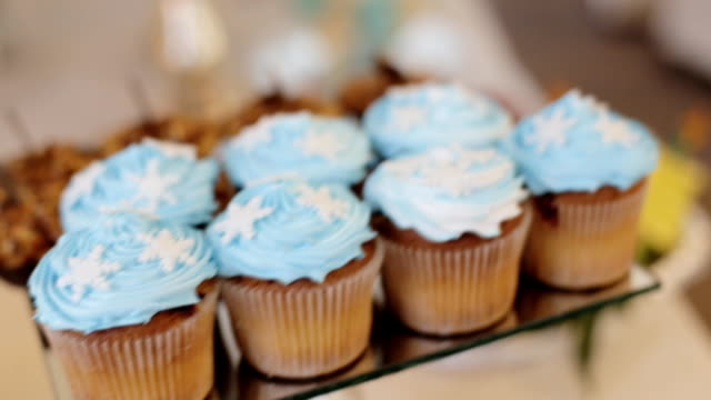 Close up shot of delicious cakes from the candy baar at a wedding hall. Dolly shot. video