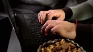 Close up shot of male hands typing working on a laptop at home video
