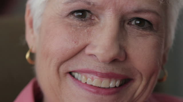 Close up shot of senior woman's face, happy video