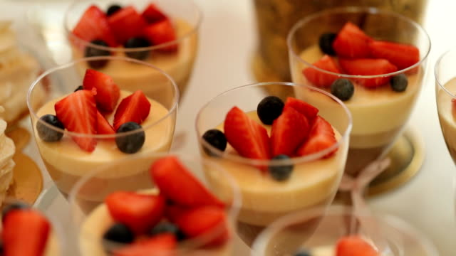 Close up shot of strawberry dessert in the glasses from the wedding candy bar. video