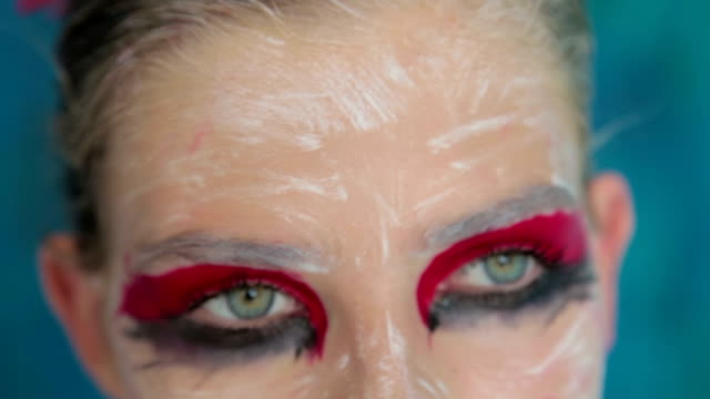 Close up shot of teen girl's eyes with creative unusual makeup video