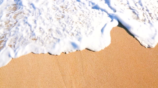 Close Up Shot of Waves Rolling Up White Sand Beach. video