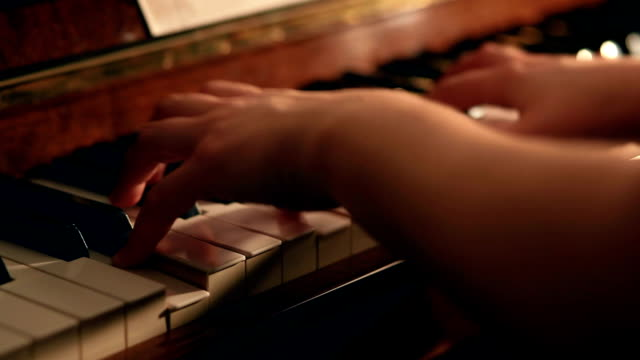 Close up shot of woman playing piano video